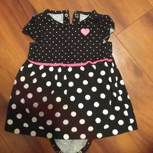 Girls size 6-9 months.  Cute bodysuit that snaps